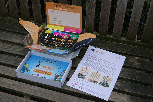 Opened seed kit on park bench.